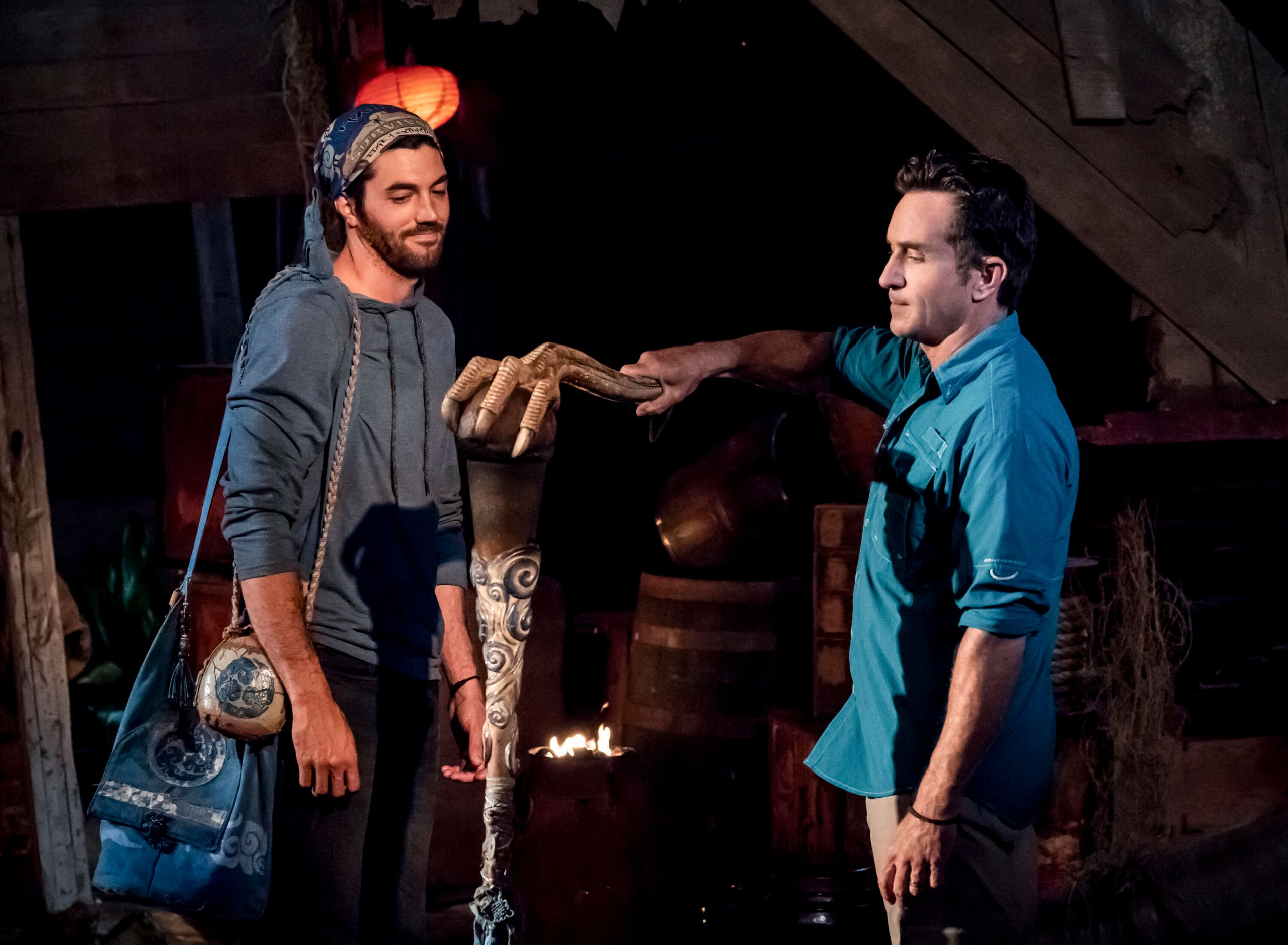 "Jeff Probst extinguishes Chris Underwood's torch at Tribal Council on the third episode of ""Survivor: Edge of Extinction."""