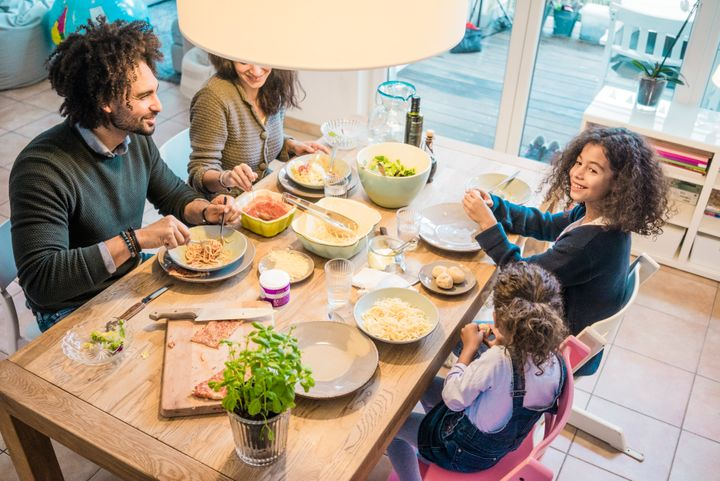 Weeknight family dinners can be hard to pull off. Here, parents give their tried-and-true advice for making it a little more possible.
