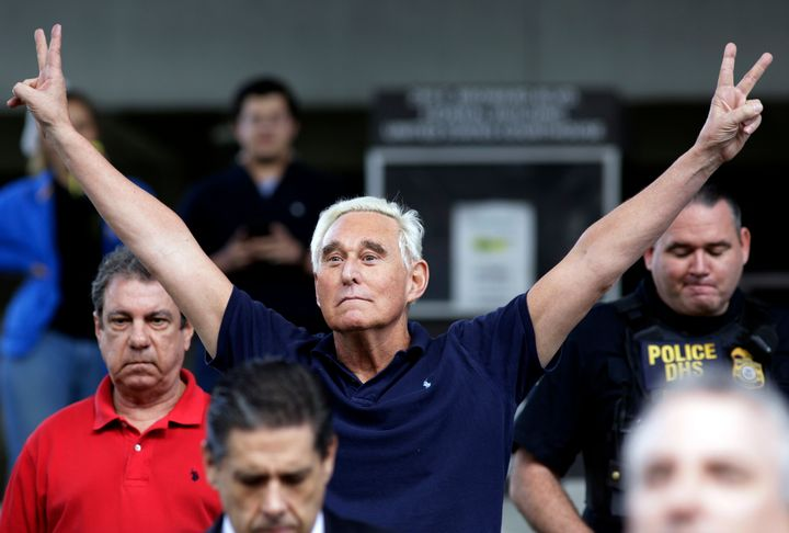 Stone exits a federal courthouse after his indictment on obstruction and lying to Congress. Heflashes the double V sign