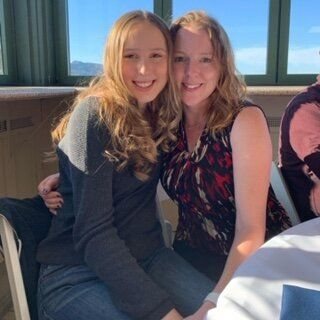 Stephanie (right) and her daughter at a wedding several months ago. They had to leave a few hours in because her daughter was in pain.