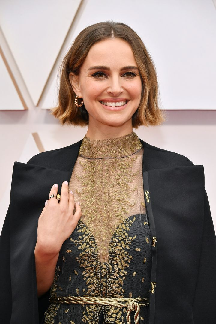 Natalie Portman wears a cape embroidered with the names of female directors to the Academy Awards ceremony on Feb. 9, 2020.