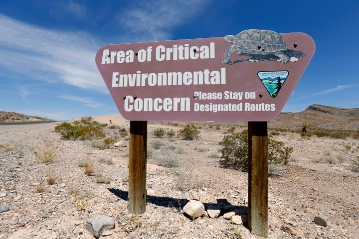 A Bureau of Land Management sign informs travelers along Highway 168, near Maopa, Nevada, to the habitat of the Mojave desert