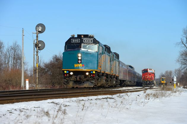 VIA's Vancouver-Toronto train passing a CN North Bay freight near Pine Orchard, Ont., on Feb. 18,