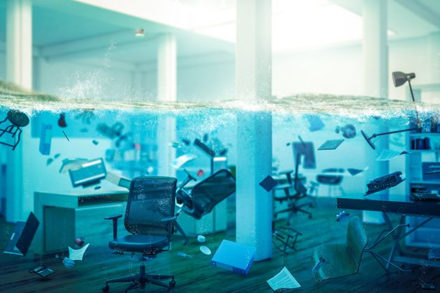 interior of an office completely flooded, objects floating in water and selective focus on a chair. 3d...