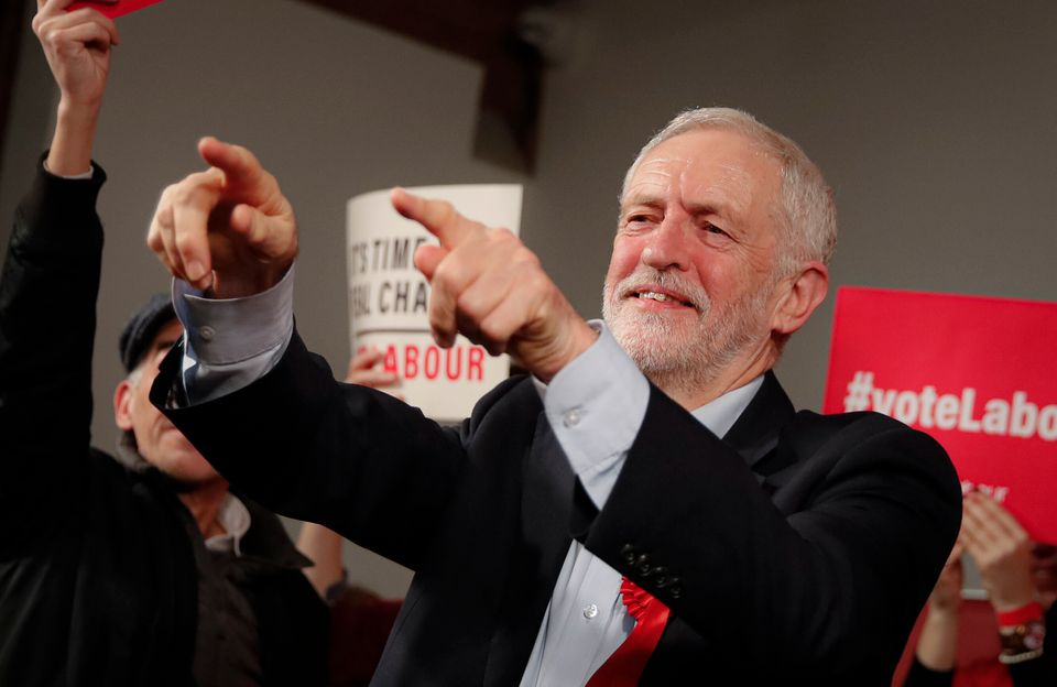 Labour Leader Jeremy Corbyn points his fingers at the end of an eve of poll rally in London, Wednesday,...