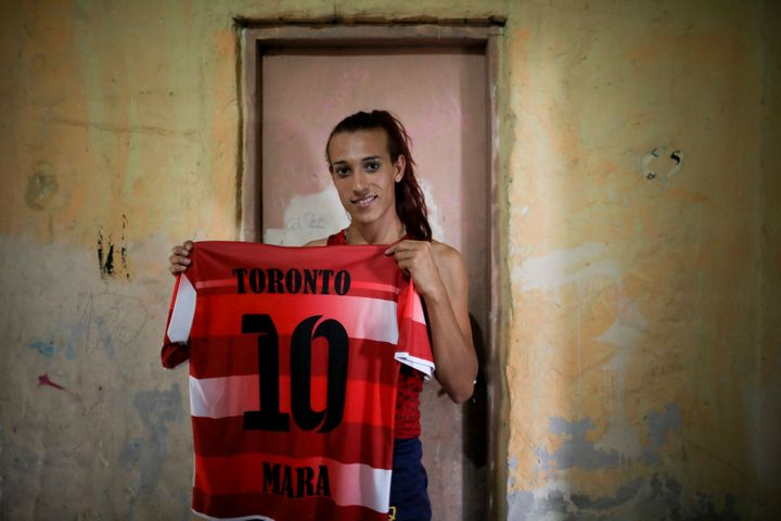 Gomez poses with her old jersey from the first amateur soccer club she played for, Toronto.