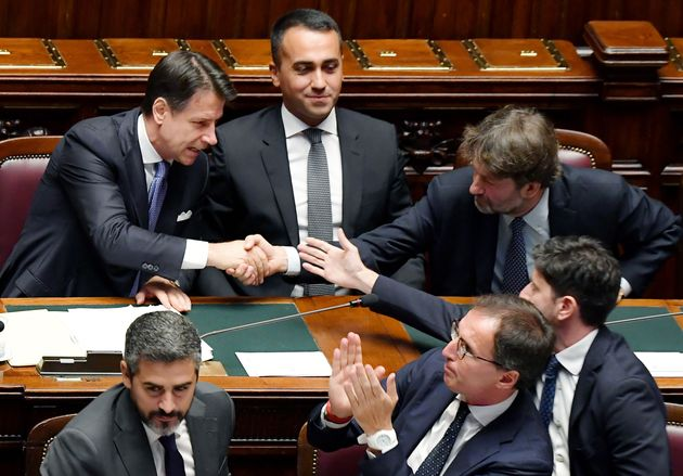 Italy's Prime Minister Giuseppe Conte (L) shakes hand with Italy's Culture minister Dario Franceschini...