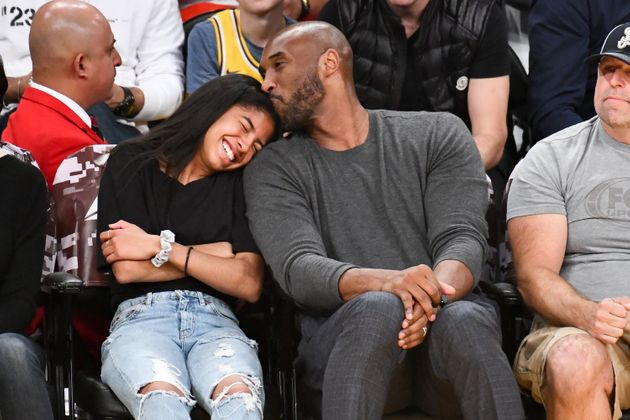 Kobe Bryant and his daughter Gianna Bryant attend a basketball game between the Los Angeles Lakers and...