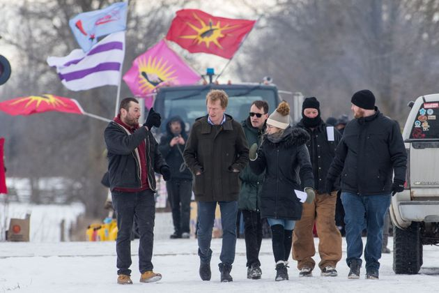 Indigenous Services Minister Marc Miller, second from left, leaves following a meeting with protesters...