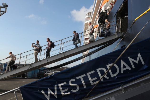 Passengers of the MS Westerdam, owned by Holland America Line disembark from the MS Westerdam, at the...