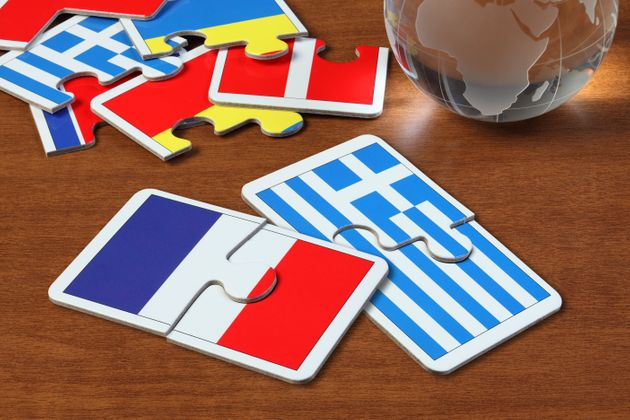 puzzle with the national flag of French and Greece on wooden