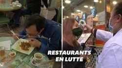Manger derrière une vitre, l'astuce des restaurants hong-kongais pour lutter contre le