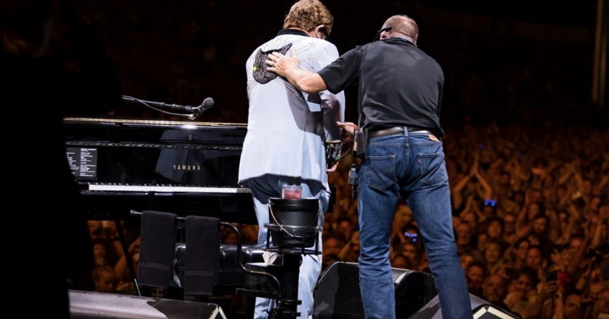 Elton John Breaks Down In Tears As He's Escorted Off Stage Mid-Concert After Losing His Voice
