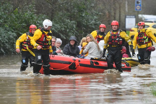 Members of the public are rescued after flooding in Nantgarw, Wales as Storm Dennis hit the
