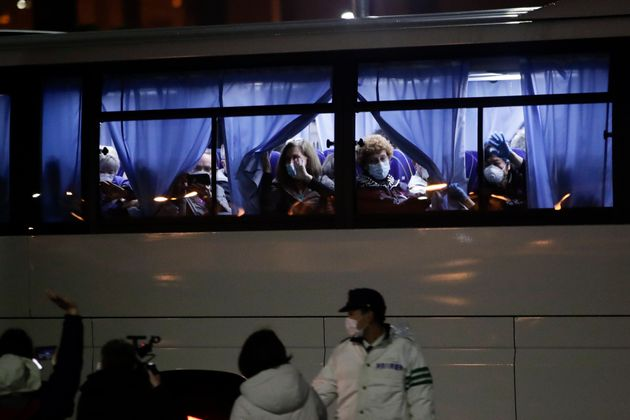 Buses carrying American passengers from the quarantined Diamond Princess cruise ship leave a port in...