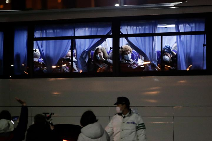 Buses carrying American passengers from the quarantined Diamond Princess cruise ship leave a port in Yokohama, near Tokyo, on