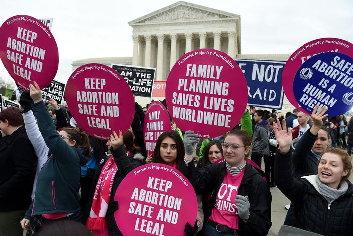 Anti-abortion and abortion rights activists square off outside the U.S. Supreme Court in Washington. Under the high court's n