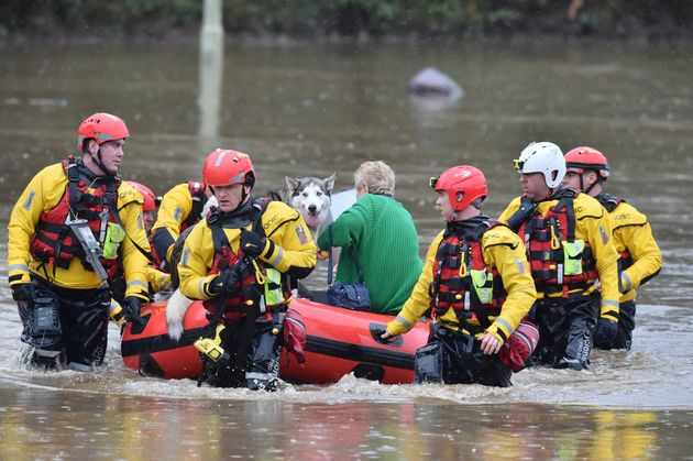 Rescue operations continue as emergency services take residents of Oxford Street, Nantgarw to safety,...