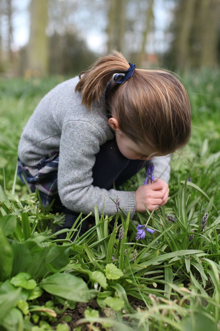 """In the podcast, the Duchess said she treasures this photo of Charlotte smelling a bluebell. """"It's moments like that that mean so much to me as a parent,"""" she said."""