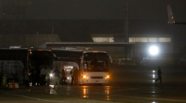 American evacuees from the Diamond Princess cruise ship board buses at Joint Base San Antonio-Lackland on Monday in San Anton