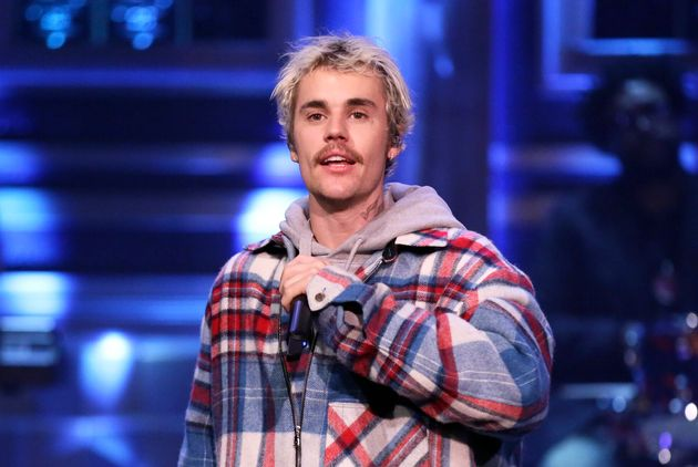 Justin Bieber (and his mustache) performs on