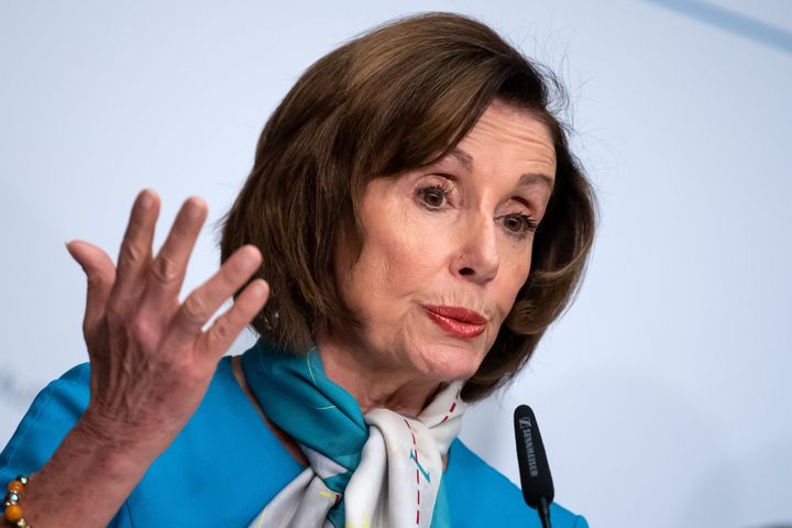 House Speaker Nancy Pelosi speaks to press at the Munich Security Conference.