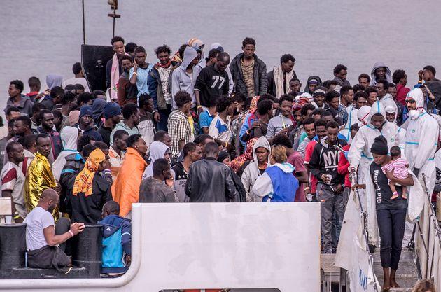 CATANIA, ITALY - JUNE 13: Migrants disembark the Italy's coastguard ship Diciotti at the port of Catania...