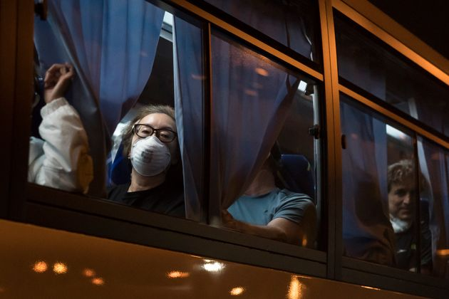 Evacuees look out from a bus as they arrive at Haneda airport on February 17, 2020 in Tokyo, Japan. (Photo by Tomohiro Ohsumi/Getty Images)