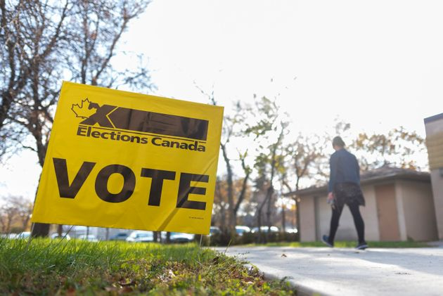 A woman leaves a voting station at Regina Senior Citizens' Centre on election day in Regina on Oct. 21,