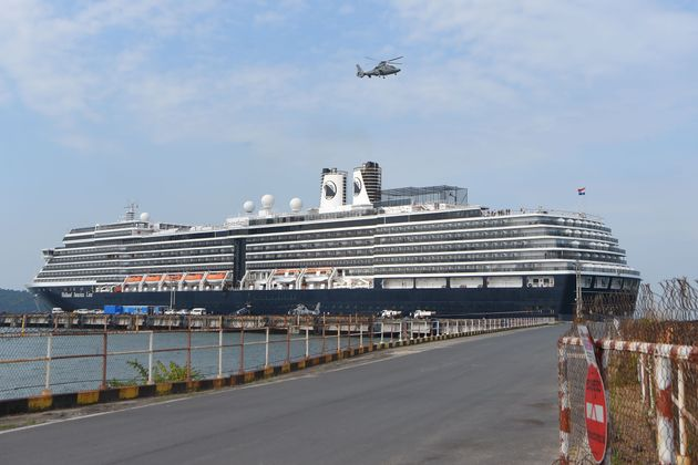 A helicopter takes off next to the Westerdam cruise ship in Sihanoukville on February 18, 2020, as authorities...