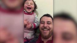 Συρία: Ηρωικός πατέρας μαθαίνει τη μικρή κόρη του να γελάει καθώς πέφτουν