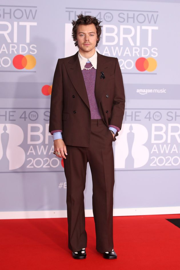 Harry posing on the Brit Awards red