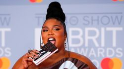 Lizzo Hits 2020 Brit Awards Red Carpet Dipped In Chocolate Bar