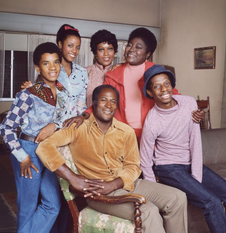 "The ""Good Times"" cast, shown in 1977, included, in front, John Amos, left, and Jimmie Walker, and in the back row from left,"