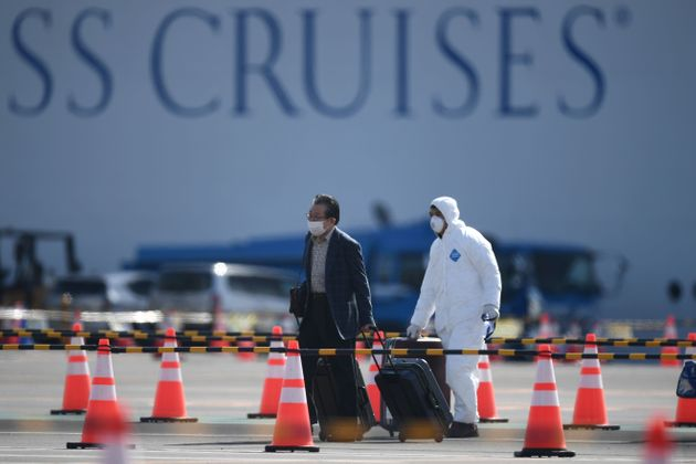 A passenger disembarks from the Diamond Princess cruise