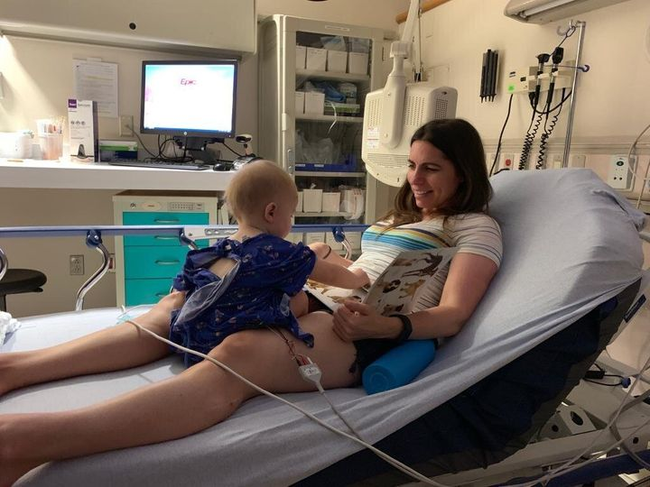 Educating and entertaining my child with books during one of his many ER visits in summer 2019.