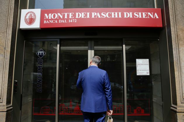 A man enters at a Monte dei Paschi di Siena bank branch, in Milan, Italy, Wednesday, July 5, 2017. The...