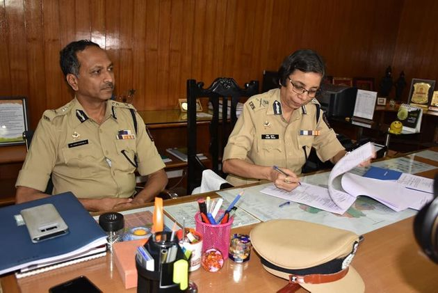 Pune Police Commissioner K.Venkatesham with former Pune Police Commissioner Rashmi Shukla in a file