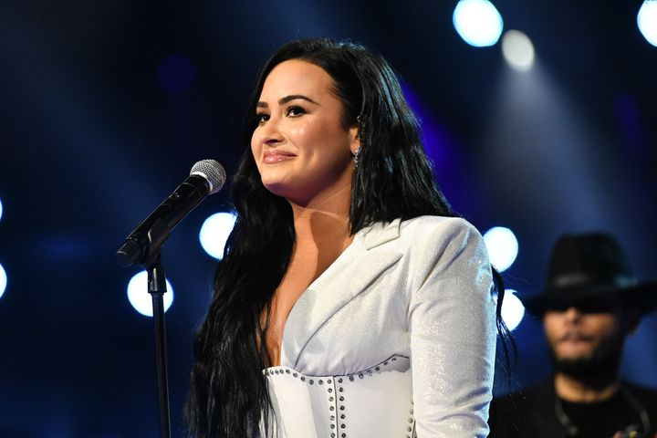 "Demi Lovato recently opened up about overexercising and wishing someone recognized the signs of her eating disorder on the podcast ""Pretty Big Deal With Ashley Graham."""