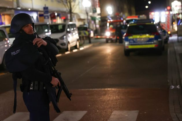 A police officer secures the area after a shooting in Hanau near Frankfurt.