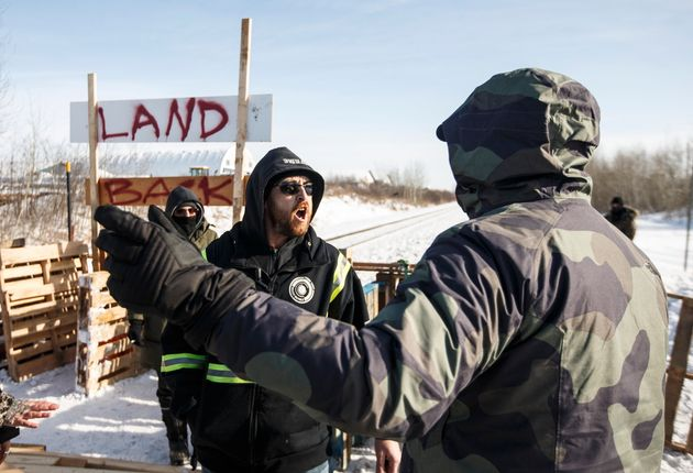 A counter-protester argues with supporters of the Wet'suwet'en hereditary chiefs near Edmonton on