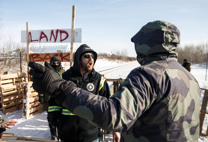 A counter-protester argues with supporters of the Wet'suwet'en hereditary chiefs near Edmonton on Wednesday.