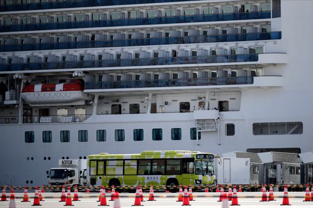 A bus carrying passengers leave the port after passengers disembarked from the quarantined Diamond Princess...