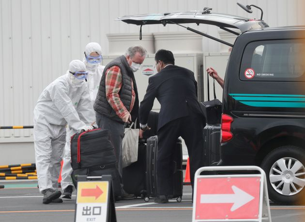 A passenger's luggages are loaded into a vehicle after disembarking the coronavirus-hit Diamond Princess...
