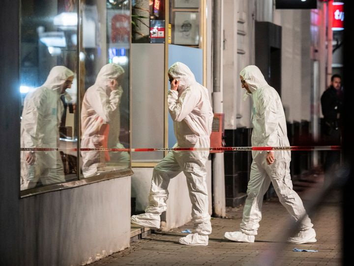 Forensics enter a building at the scene after a shooting in central Hanau, Germany, on Thursday.
