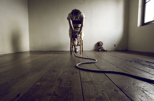 Young woman tied to a chair in a empty