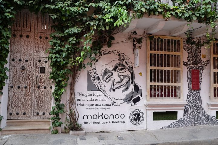 """CARTAGENA of INDIAS, COLOMBIA - JANUARY 29, 2016: A portrait of legendary Colombian novelist Gabriel Garcia Marquez appears on a mural outside a boutique hotel with one of his quotes reading: """"no place in life is more sad than an empty bed"""" on January 29, 2016 in Cartagena, Colombia. (Photo by Kaveh Kazemi/Getty Images)"""