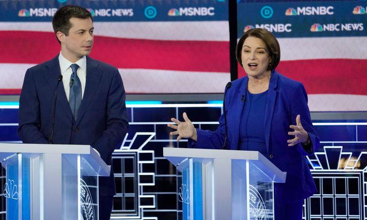 Senator Amy Klobuchar speaks as former South Bend Mayor Pete Buttigieg listens at the ninth Democratic 2020 U.S. Presidential