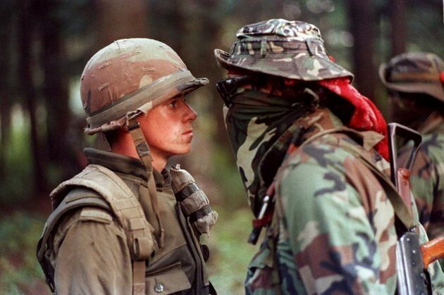 "This photo, which became representative of the Oka Crisis, shows soldier Patrick Cloutier and Mohawk warrior Brad Laroque, nicknamed ""Freddy Kruger,"" in a face-to-face standoff in a forested area of the Kanesatake reserve on Sept. 1, 1990."