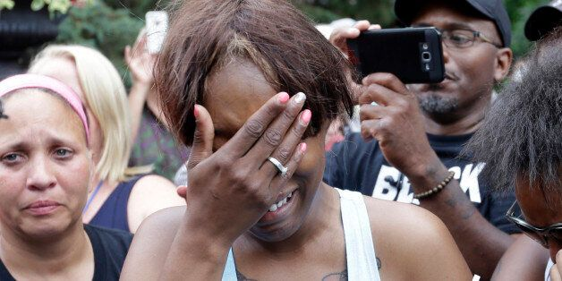 Diamond Reynolds, the girlfriend of Philando Castile of St. Paul, cries outside the governor's residence in St. Paul, Minn.,